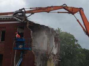 Morrill Hall being demolished by construction equipment